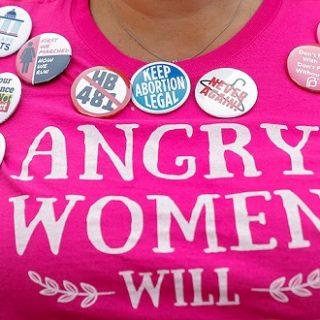 """全美堕胎立法战火蔓延:权力舞台上的""""行为艺术""""?"""