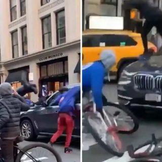 纽约暴力混混们当街用单车狠砸宝马车,简直可怕...